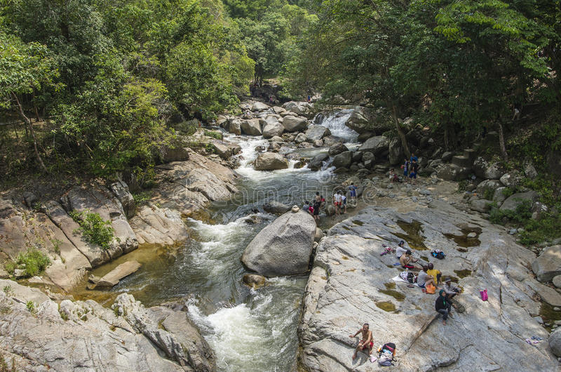 Chamang Waterfall, Bentong, Malaysia - July 18, 2015: Tourists enjoying the bliss of Chamang waterfall in Pahang during long seaso. Bliss of Chamang waterfall in royalty free stock photos