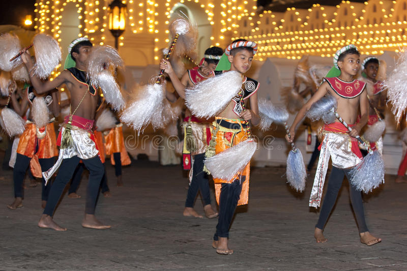 Chamara Dancers perform a dance whereby the yak tails they hold symbolically fan the Sacred Tooth Relic during the Esala Perahara. Kandy, Sri Lanka. The Esala stock image