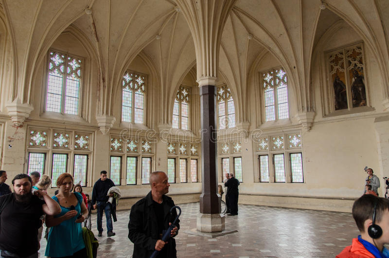 Chamber of the biggest gothic castle in Europe. Photo shows tourists visitting Chamber of Malbork castle in Poland. The castle built in gothic style used to be royalty free stock images
