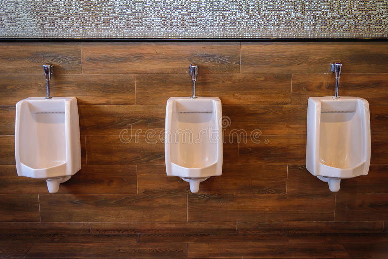 Chamber pots or urinal in men public toilet stock photography