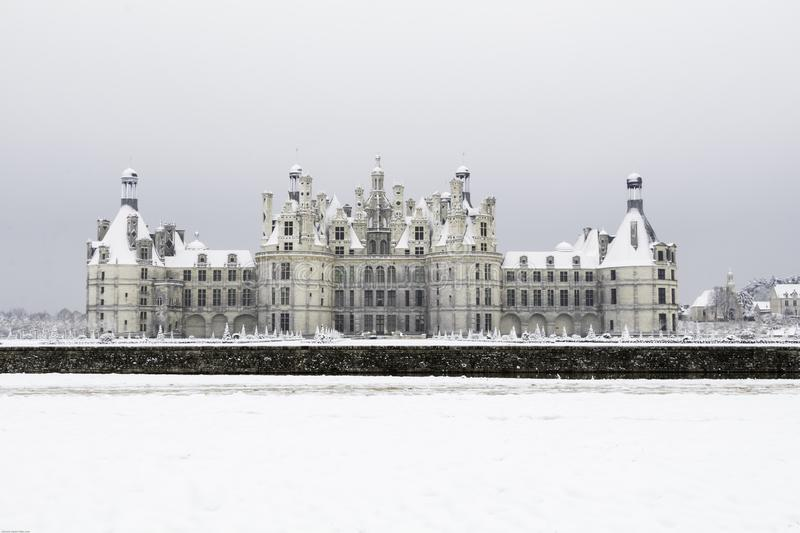 Chambord castles under the snow in February, the Loire Valley, France. Chambord castles under the snow in February, with light fog after noon the Loire Valley stock photos