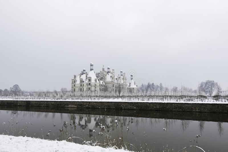 Chambord castles under the snow in February, the Loire Valley, France. Chambord castles under the snow in February, with light fog after noon the Loire Valley stock photography