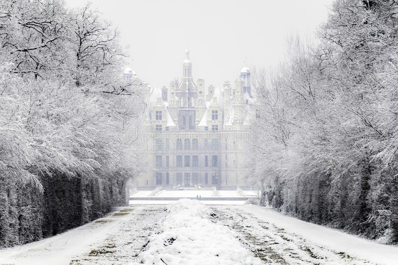 Chambord castles under the snow in February, the Loire Valley, France. Chambord castles under the snow in February, with light fog after noon the Loire Valley stock images