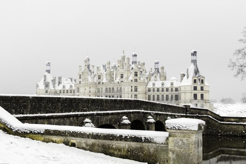 Chambord castles under the snow in February, the Loire Valley, France. Chambord castles under the snow in February, with light fog after noon the Loire Valley stock image
