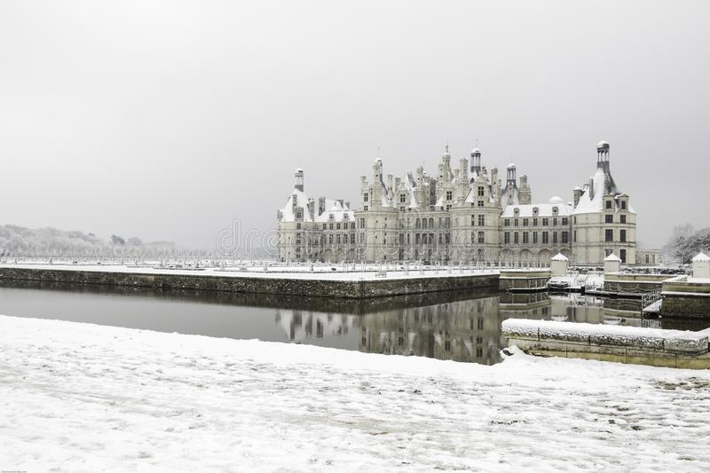 Chambord castles under the snow in February, the Loire Valley, France. Chambord castles under the snow in February, with light fog after noon the Loire Valley stock photo