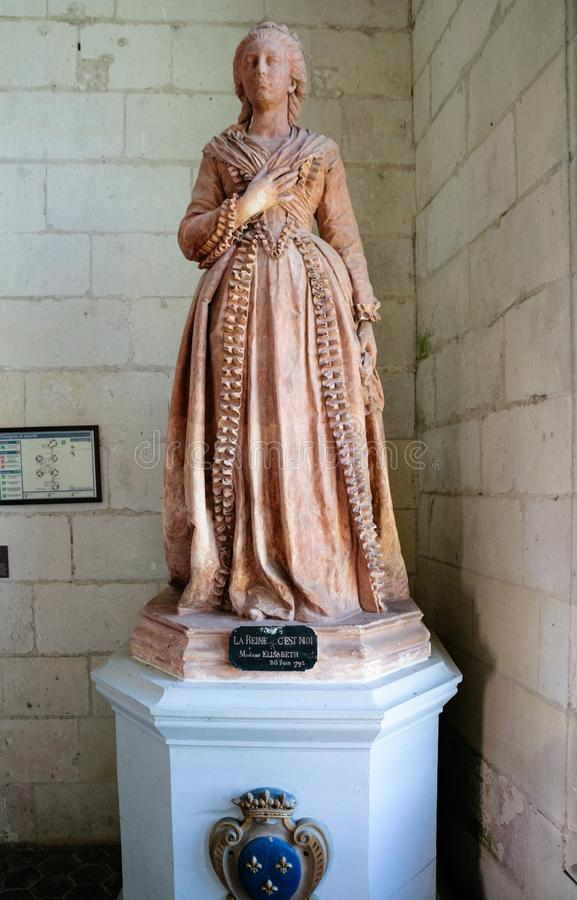 Statue of Madame Elisabeth in Chateau de Chambord. CHAMBORD, FRANCE - JULY 7, 2010: statue of Madame Elisabeth, the sister of King Louis XVI in castle Chateau de royalty free stock images