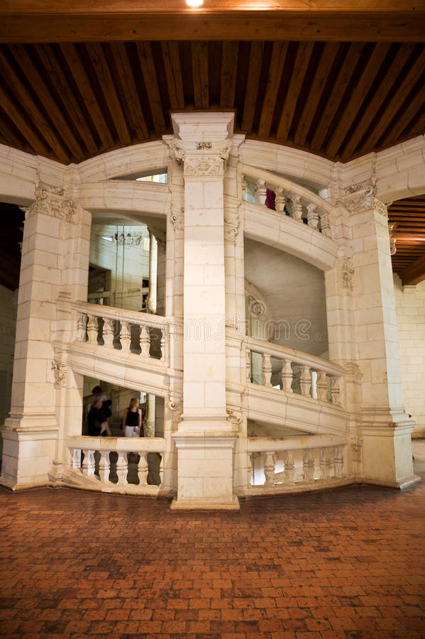 Chambord staircase. Famous double staircase from Chambord Chateau, France Motion blurred people royalty free stock images