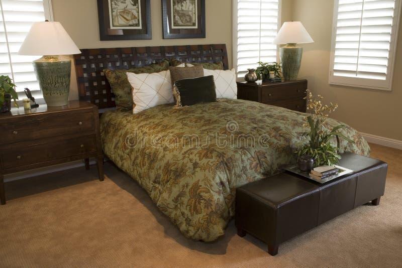 Chambre à coucher à la maison de luxe. photos stock