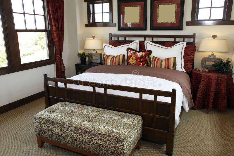 Chambre à coucher à la maison de luxe image libre de droits