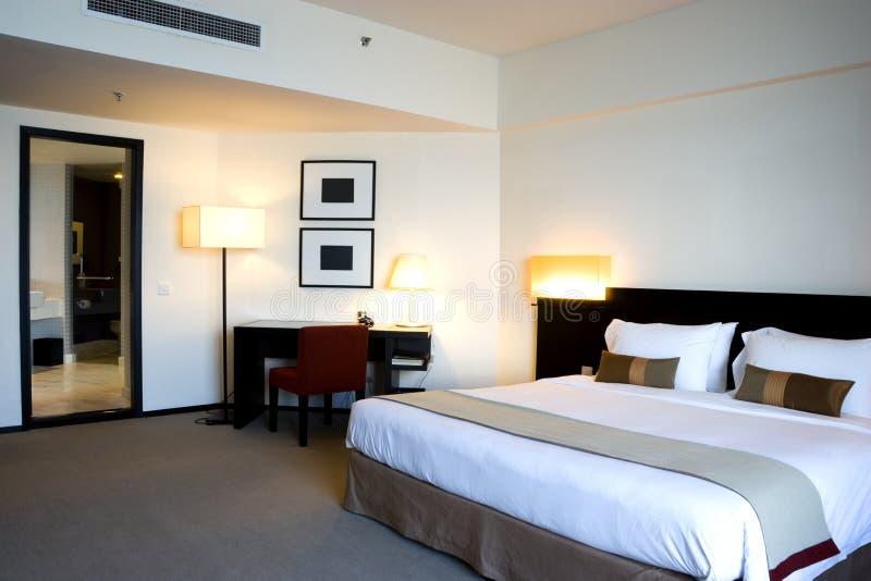 Chambre à coucher d'hôtel images stock
