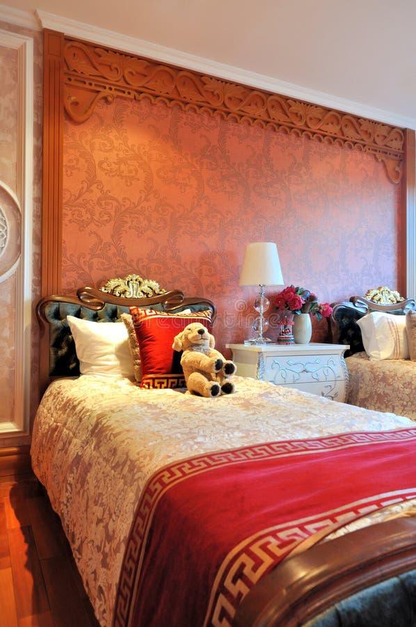 Chambre à coucher pour des gosses dans le type vaillant photos stock