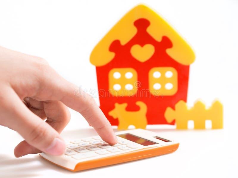 Chambre, calculatrice et argent image libre de droits