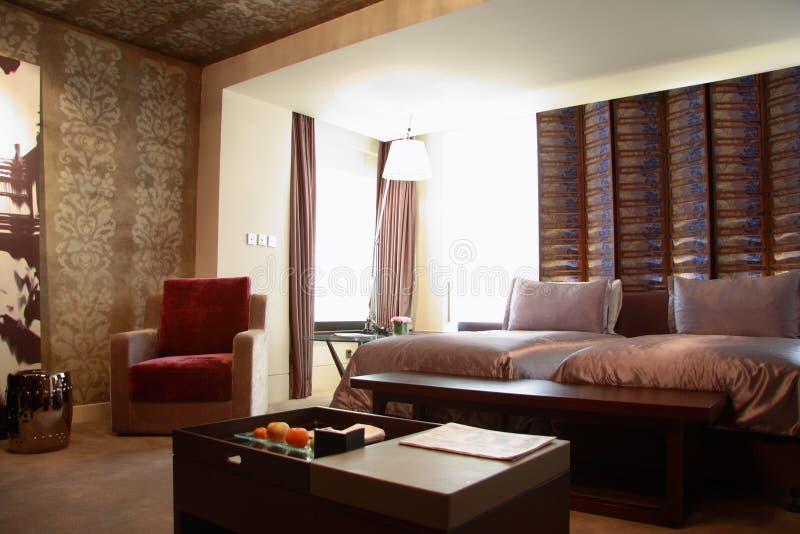 Chambre d'hôtel ou chambre à coucher image stock