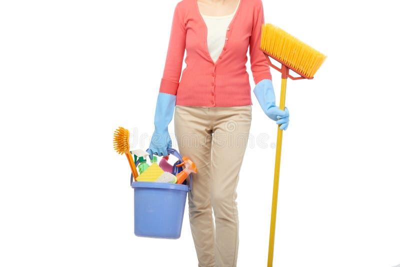 Chambre de nettoyage de femme de charge photos stock