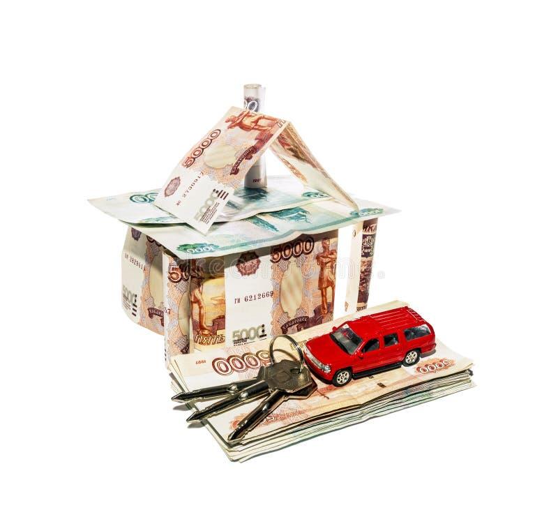 Chambre faite de billets de banque avec une voiture de jouet et un groupe de clés images libres de droits