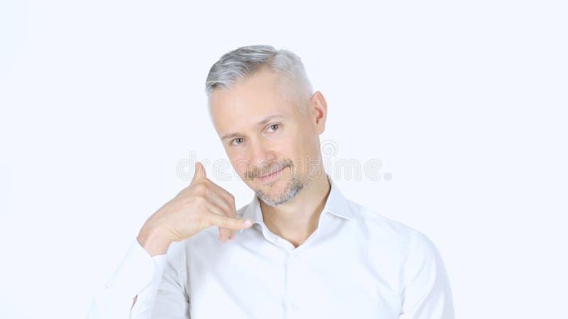 Chame-me gesto pelo homem de negócios, junte-se me, Whitebackground foto de stock