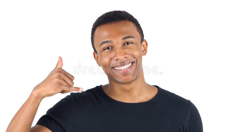 Chame-me gesto pelo homem negro foto de stock