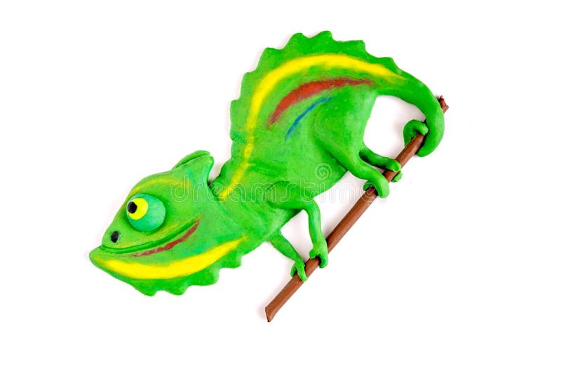 Chameleon from plasticine on a white background. Children`s crafts from plasticine. Creativity from plasticine. Sculpting for royalty free stock photo