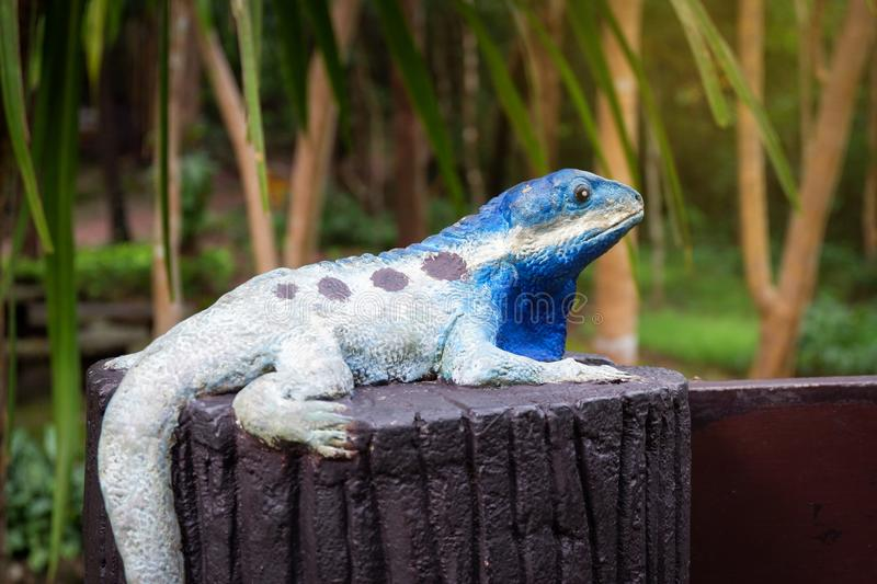 Chameleons statue. In color full action royalty free stock image