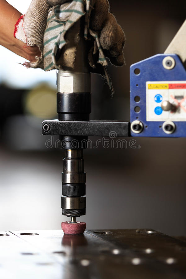 Chamfer hole by pneumatic tapping machine. Hole chamfering by pneumatic tapping machine stock photo