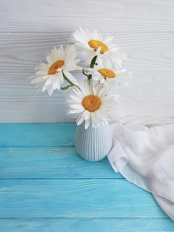 chamomile bouquet shawl of a blossom natural vase retro textile on a wooden arrangement background, fabric stock photography