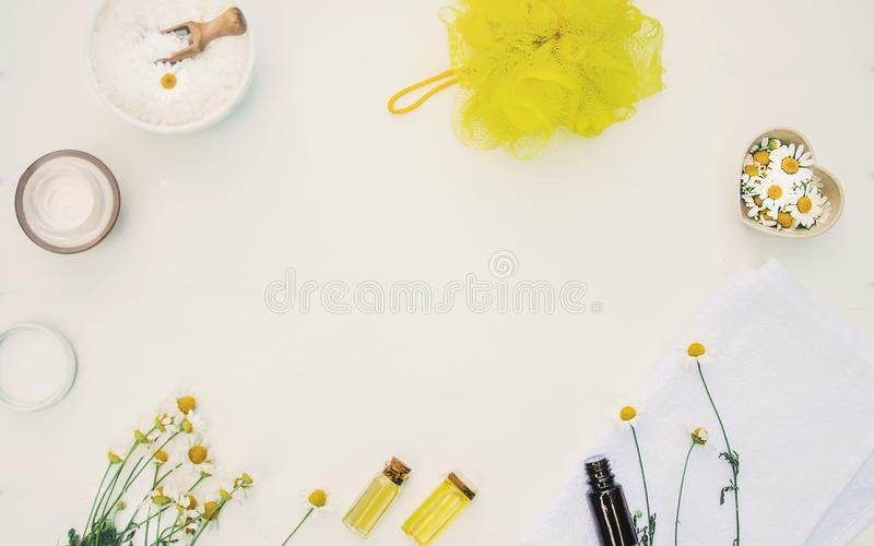Chamomile extract in a small bottle. Selective focus stock photo
