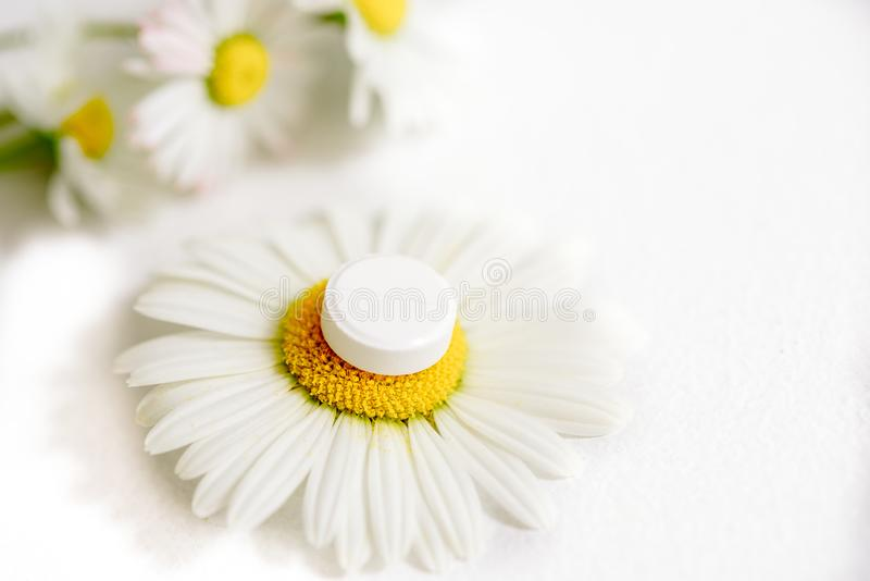 Chamomile Flowers, Homeopathic Medicine  White Tablets On