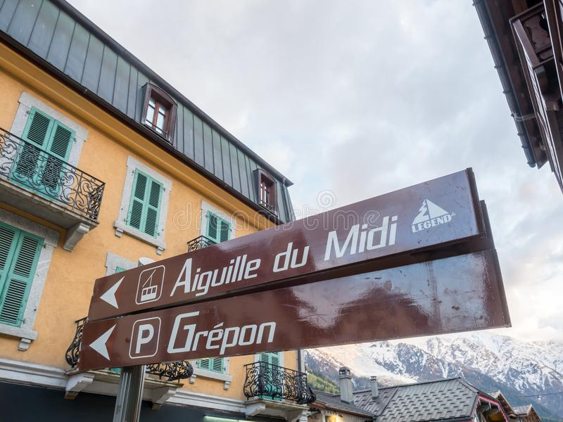 Traffic signs in Chamonix Mont Blanc in France. CHAMONIX-MONT-BLANC, FRANCE - APRIL 15 : Traffic signs to Aiguille du Midi, cable car to Mont Blanc peak, in royalty free stock photography