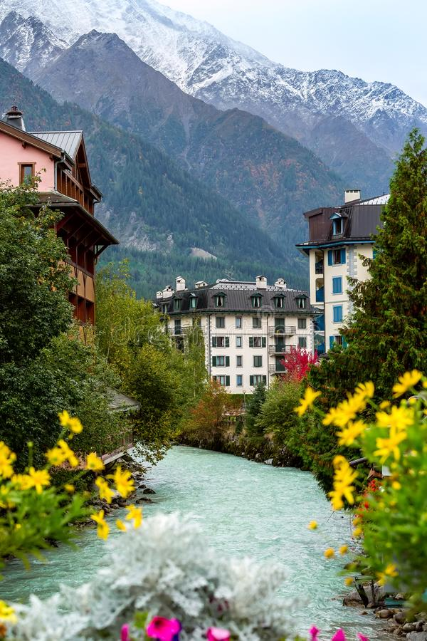 River and houses, flowers in center of Chamonix, France. stock photo