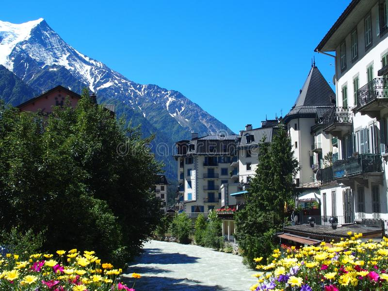 CHAMONIX MONT BLANC village with high alpine mountains range landscape in french ALPS. With colorful flowers at Arve river in FRANCE with clear blue sky in 2016 royalty free stock image