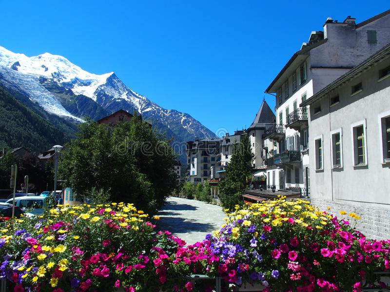 CHAMONIX MONT BLANC village with high alpine mountains range landscape in french ALPS. With colorful flowers at Arve river in FRANCE with clear blue sky in 2016 royalty free stock photos