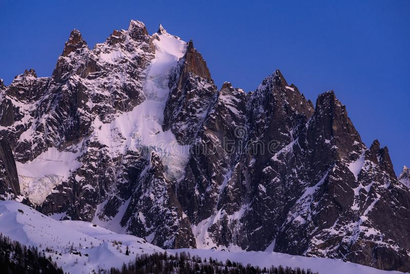 The Chamonix Needles at twilight. Mont Blanc mountain range, Chamonix, Haute-Savoie, Alps, France. The Chamonix Needles Aiguille du Plan and Dent du Crocodile at stock photo