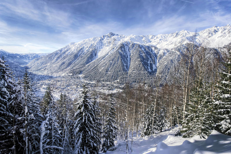 Chamonix Town French Alps. The tourist attraction town of Chamonix seen beside the French Alps/mountain terrains. View taken from the train going up La Mer De stock image