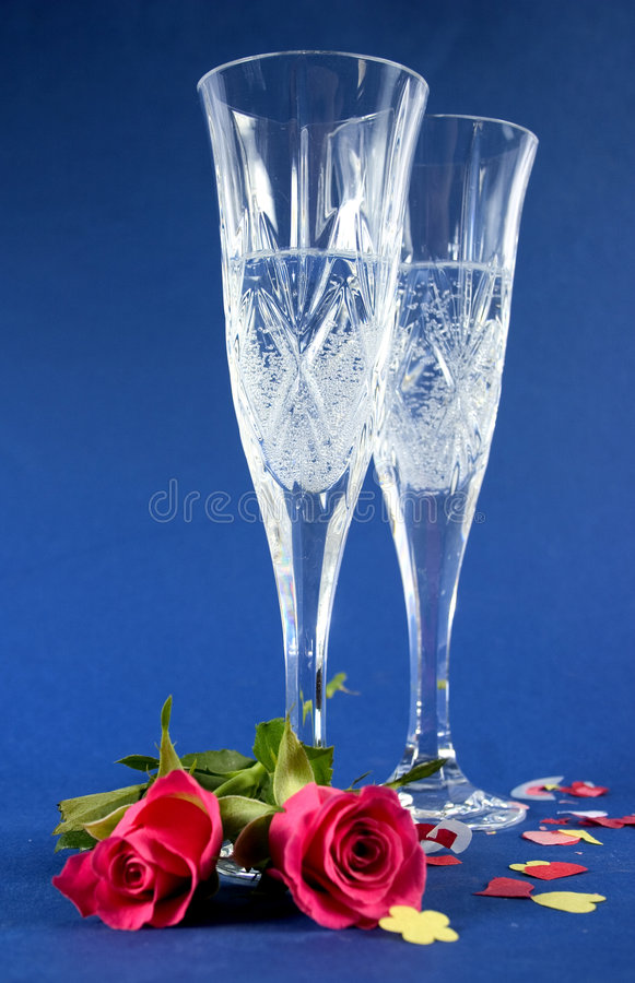 Champán y rosas fotos de archivo libres de regalías