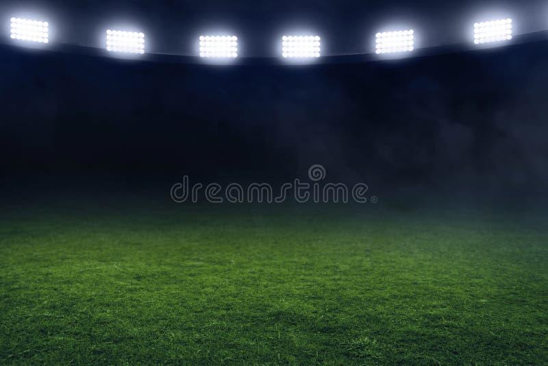 Champ de stade de football la nuit images libres de droits