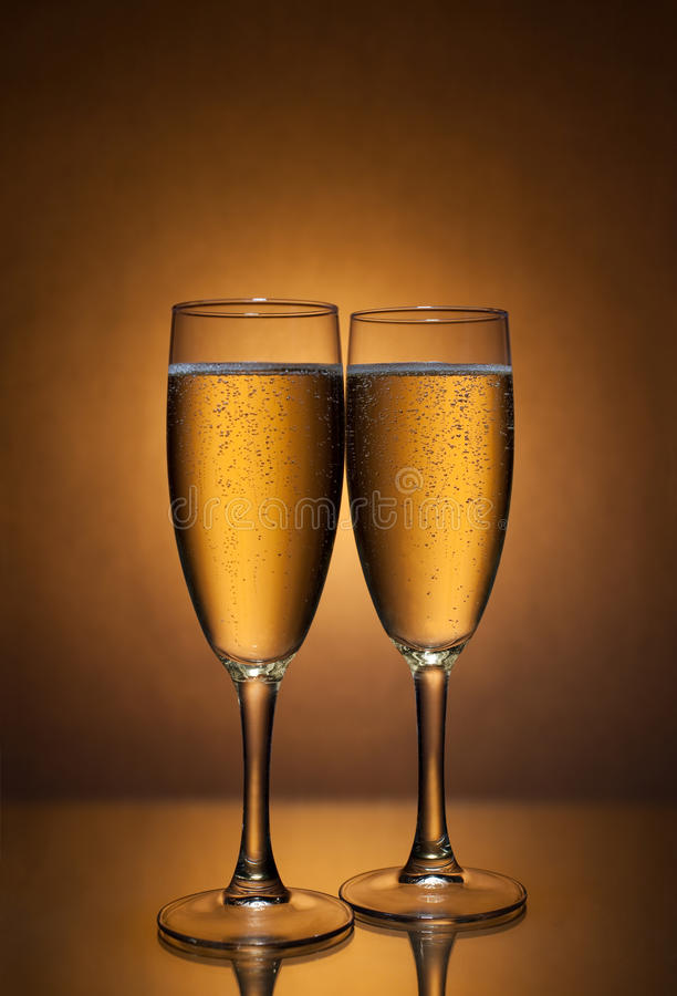 Champagne. Glasses filled with champagne on table royalty free stock photography