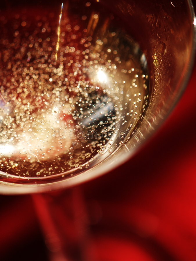 Champagne. Sparkle from above on red stock photography