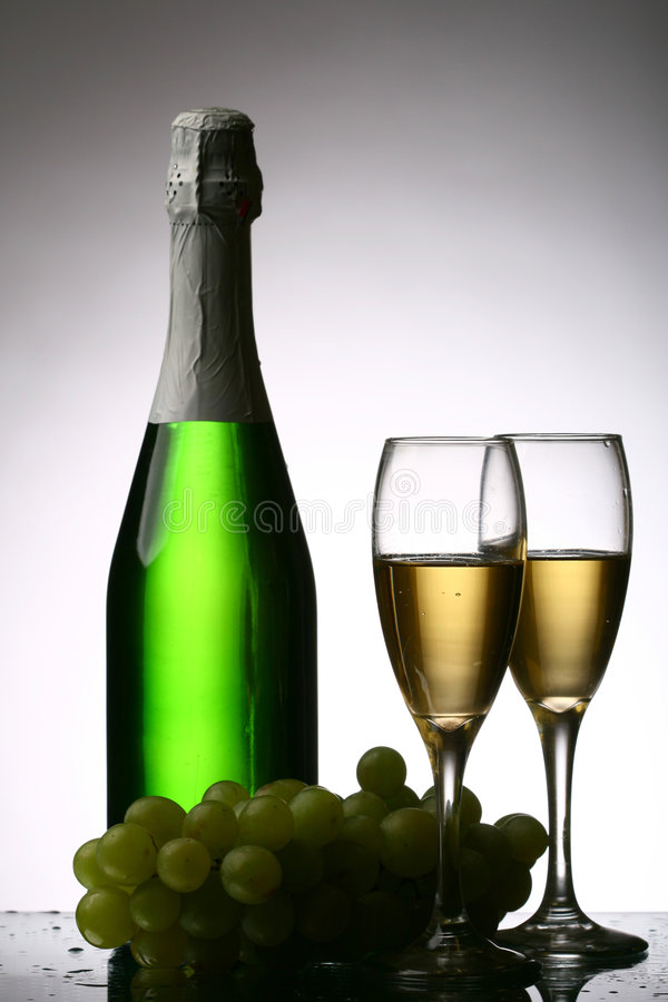 Champagne. Grape and green bottle stock photo