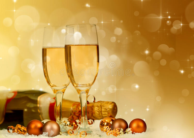 Champagne against fireworks and holiday lights royalty free stock images