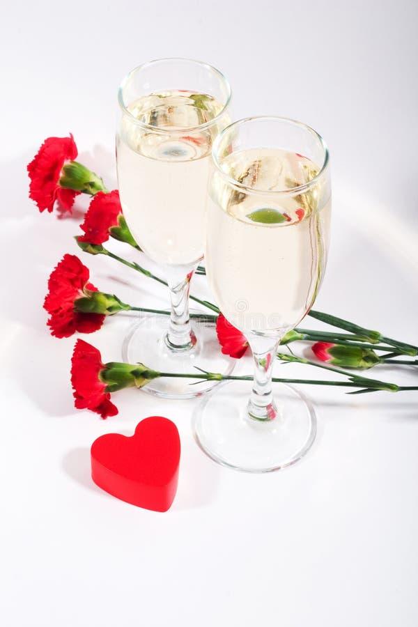 Champagne, anjers en hart stock fotografie