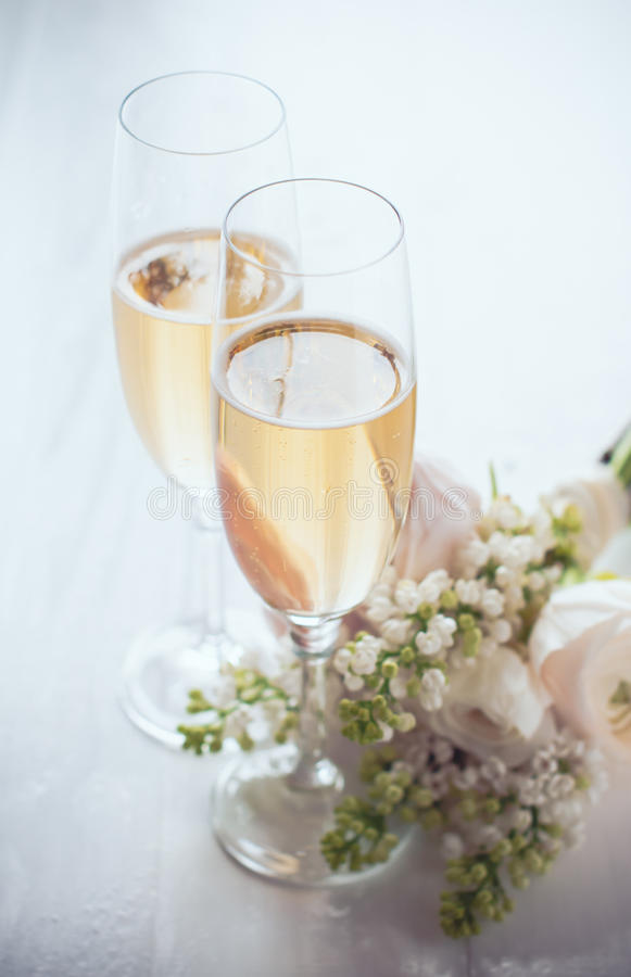 Champagne and a beautiful bouquet stock images