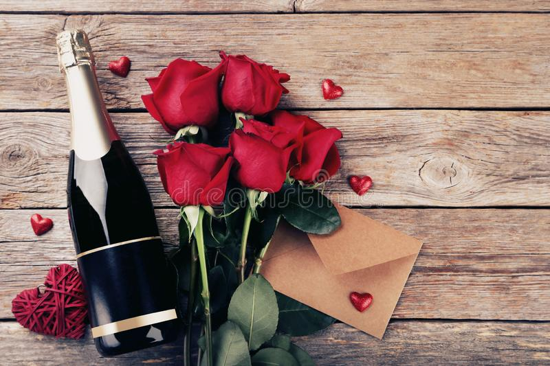 Champagne bottle with red roses stock image