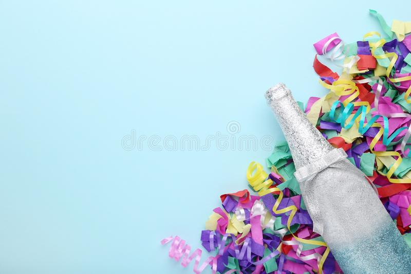 Champagne bottle with confetti royalty free stock photography