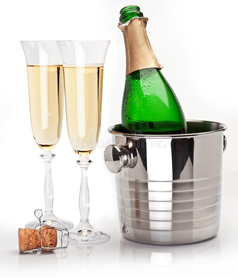 Champagne bottle in cooler royalty free stock photo