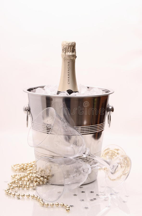 Champagne bottle in cooler and two champagne glasses, deco royalty free stock image