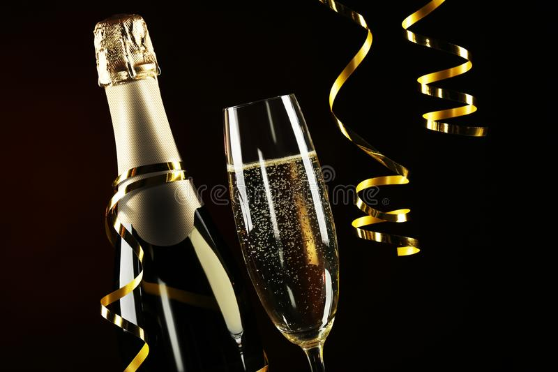 Champagne bottle with glass stock photo