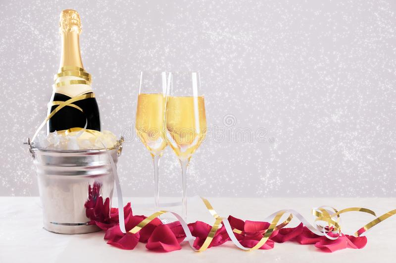 Champagne bottle with glasses against a stars backgrounds royalty free stock images
