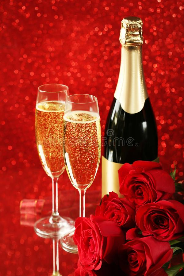 Champagne bottle with glasses royalty free stock images