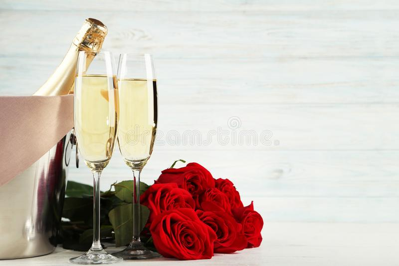 Champagne bottle with glasses royalty free stock photography