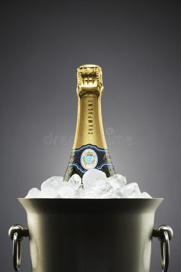 Champagne bottle in ice bucket royalty free stock images